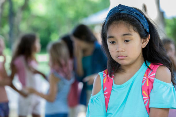 sad girl being bullied outside school - philippines girl stock photos and pictures