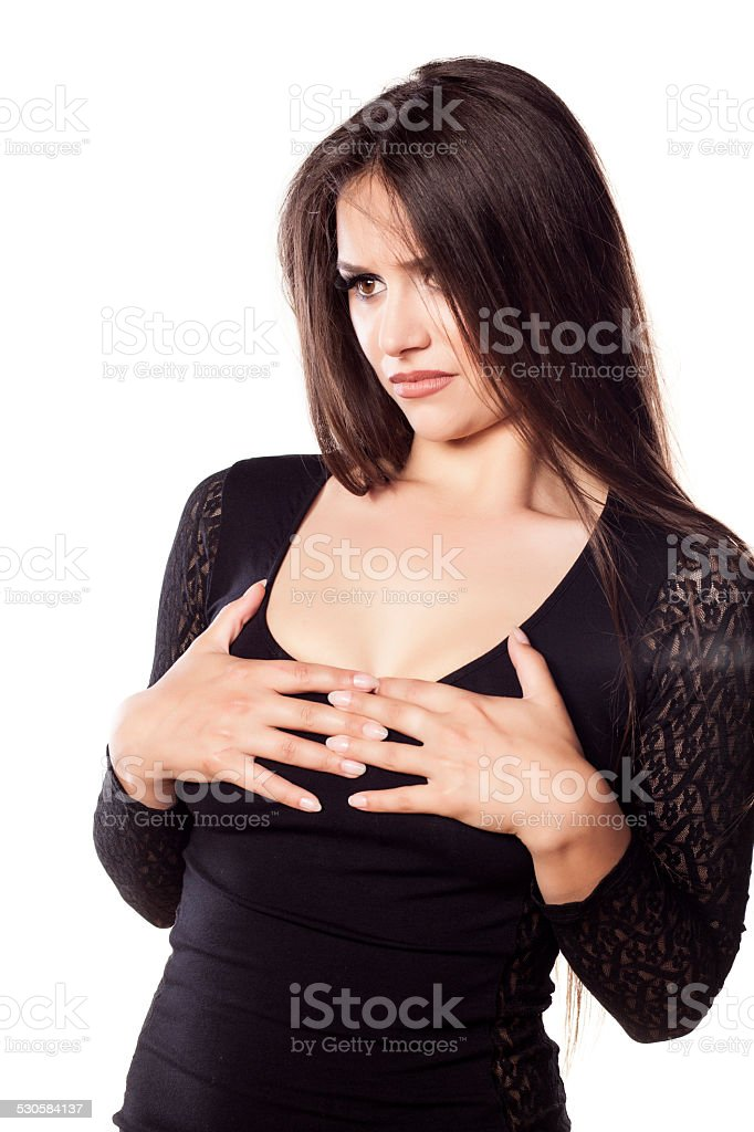 Sad girl holding her breasts stock photo