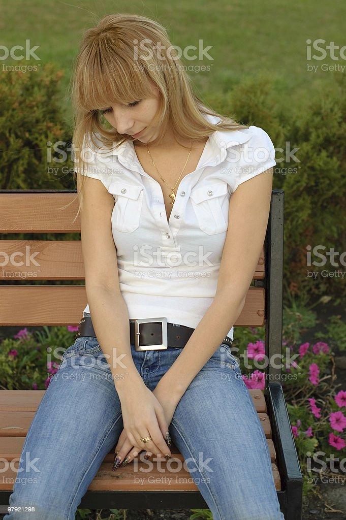 sad girl in the park royalty-free stock photo