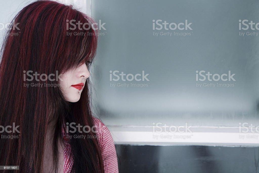 Sad girl in the window royalty-free stock photo