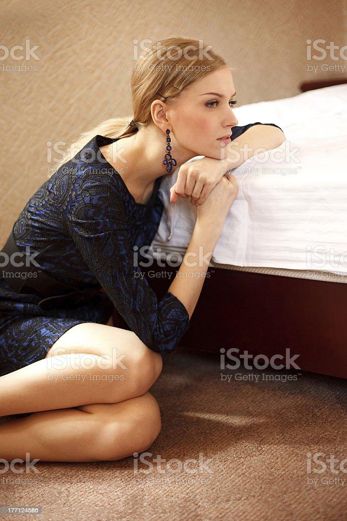 Sad girl is sitting on the floor stock photo
