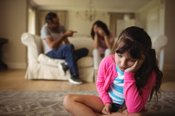 sad girl listening to her parents arguing - fighting stock photos and pictures