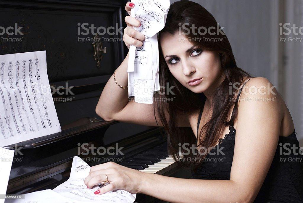sad girl near piano royalty-free stock photo