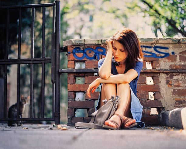 sad girl outside - psychiatric ward stock photos and pictures