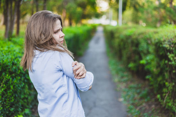 Sad girl standing in the park stock photo