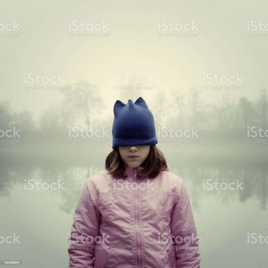 Sad girl with eyes covered by cap royalty-free stock photo