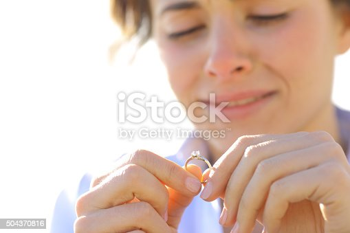 istock Sad girlfriend looking her engagement ring 504370816