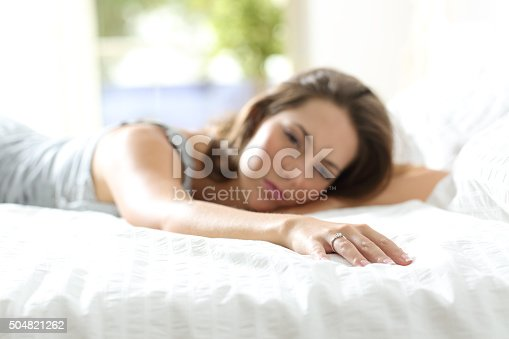 istock Sad girlfriend missing her boyfriend on the bed 504821262