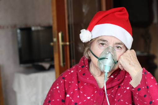 874789168 istock photo Sad ill senior woman during Christmas 1191075890