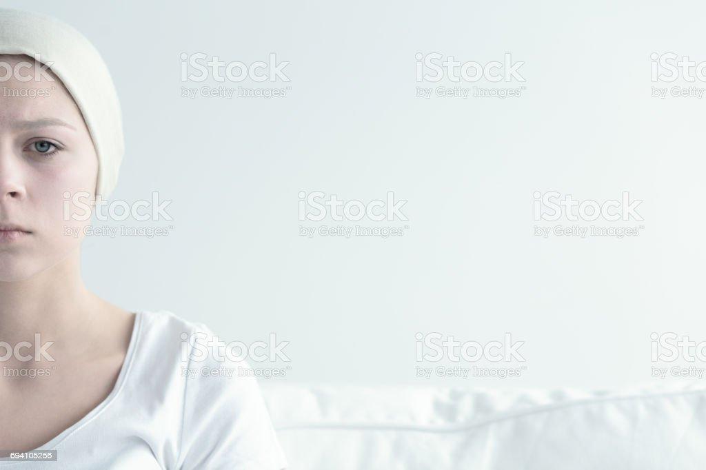 Sad, ill woman stock photo