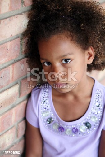 istock sad little african-american girl 157704980