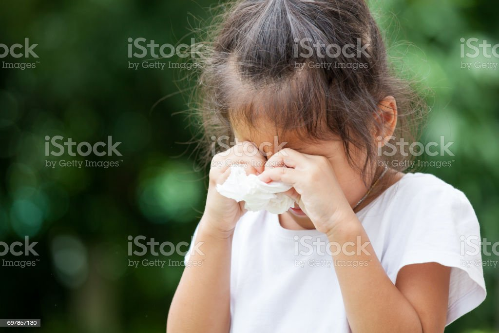 Sad little asian girl crying and holding tissue on her hand royalty-free stock photo