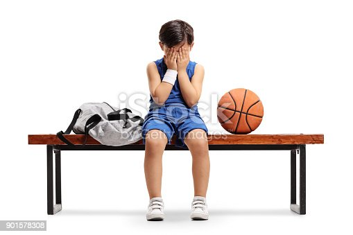 istock Sad little basketball player sitting on a bench 901578308