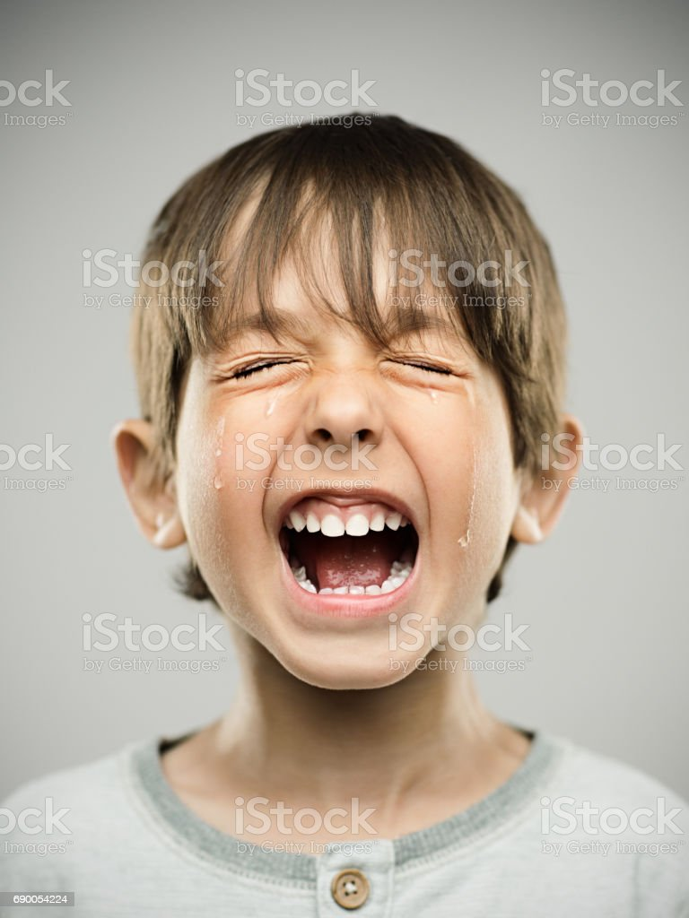 Sad little boy crying loudly stock photo