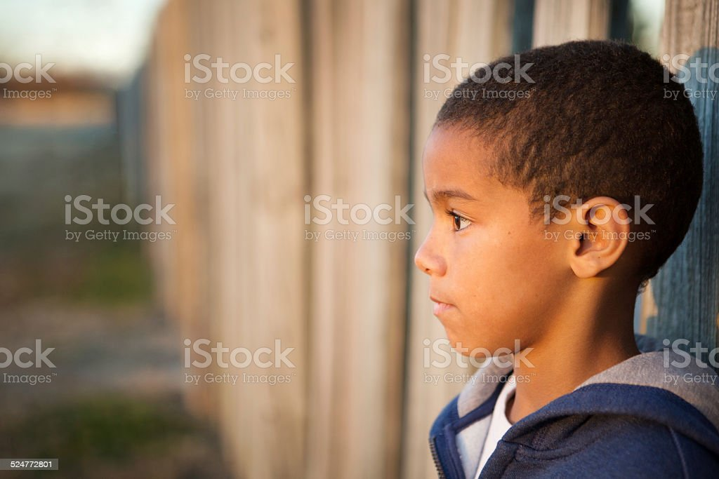 Sad little boy stock photo
