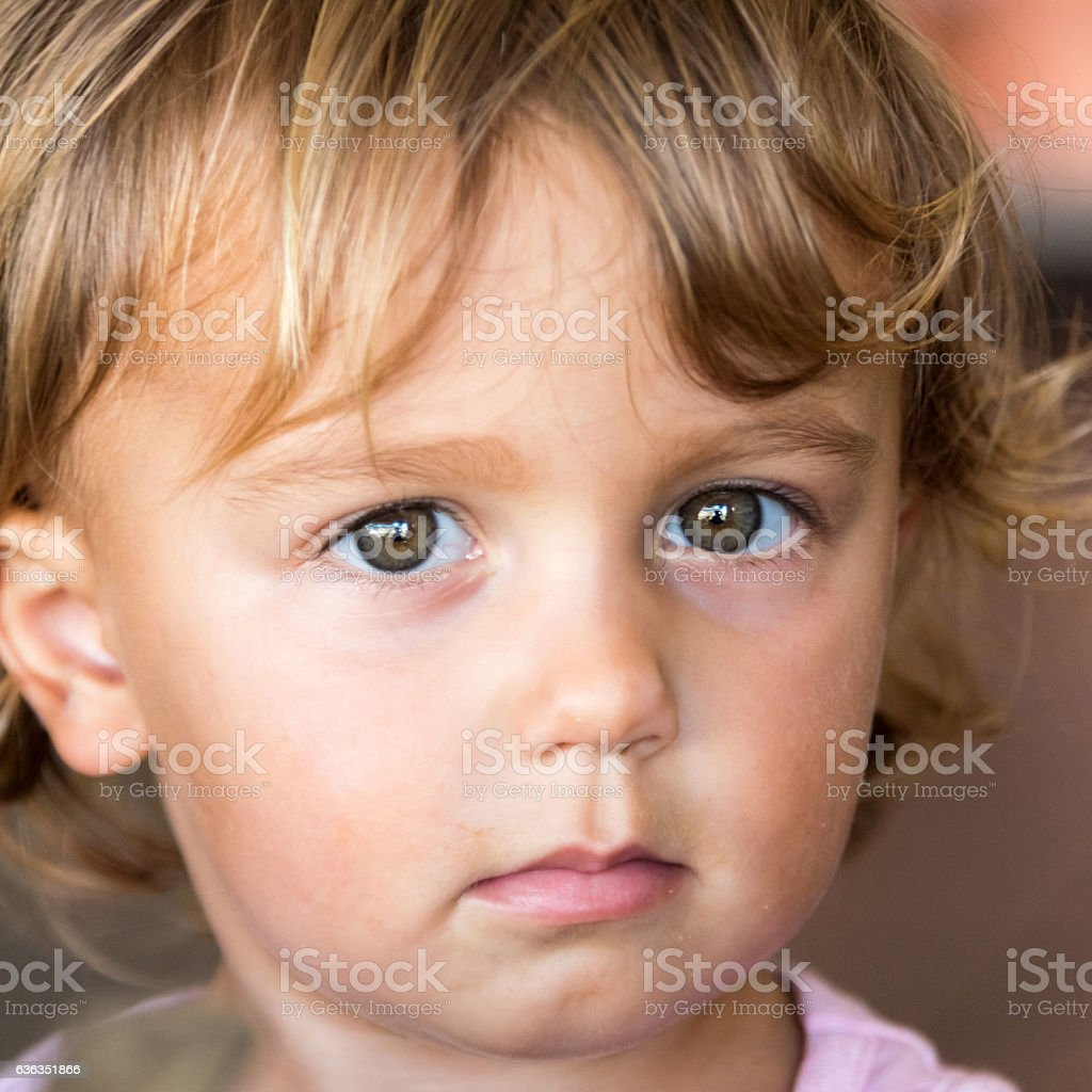 sad little child looking at the camera stock photo