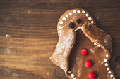 Sad little gingerbread man covering his face