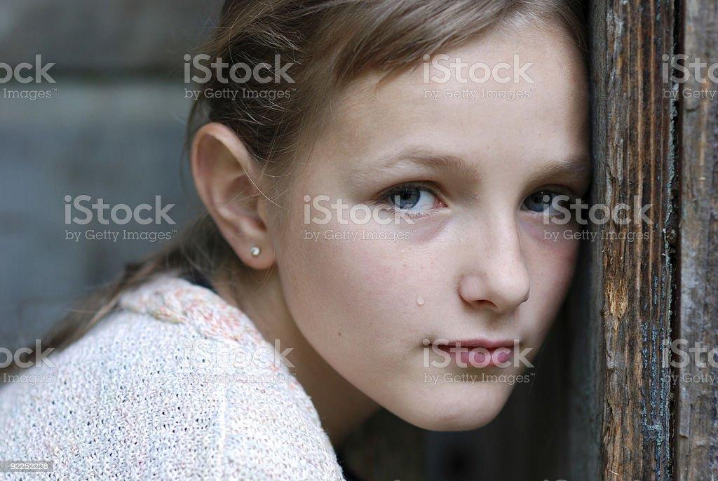 Sad little girl is crying stock photo