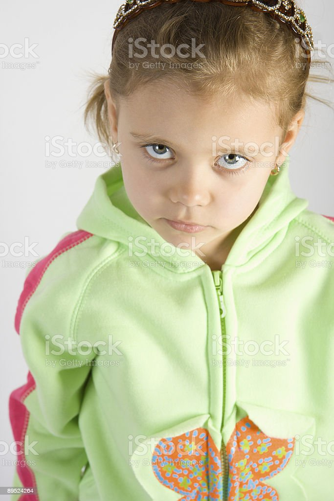 Sad little girl looking up royalty-free stock photo
