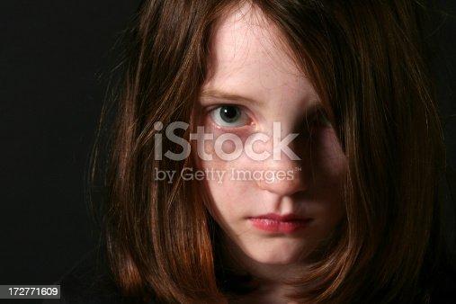 Very sad girl looking at the camera