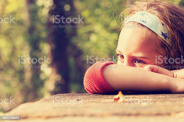 Sad little girl. Little mixed-race girl with a sad expression on the face. 2015 Stock Photo