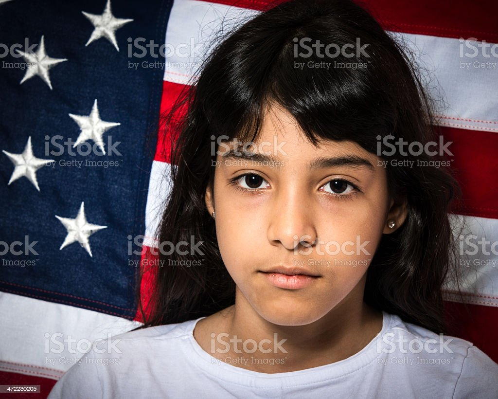 Sad Little hispanic immigrant stock photo