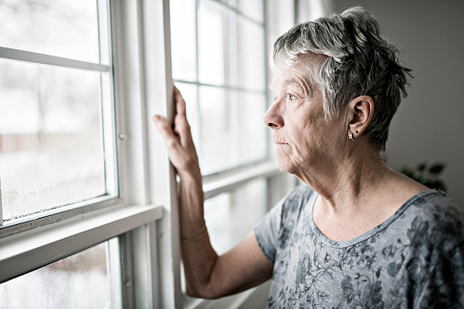 A Sad and lonely 60 years old senior in is apartment