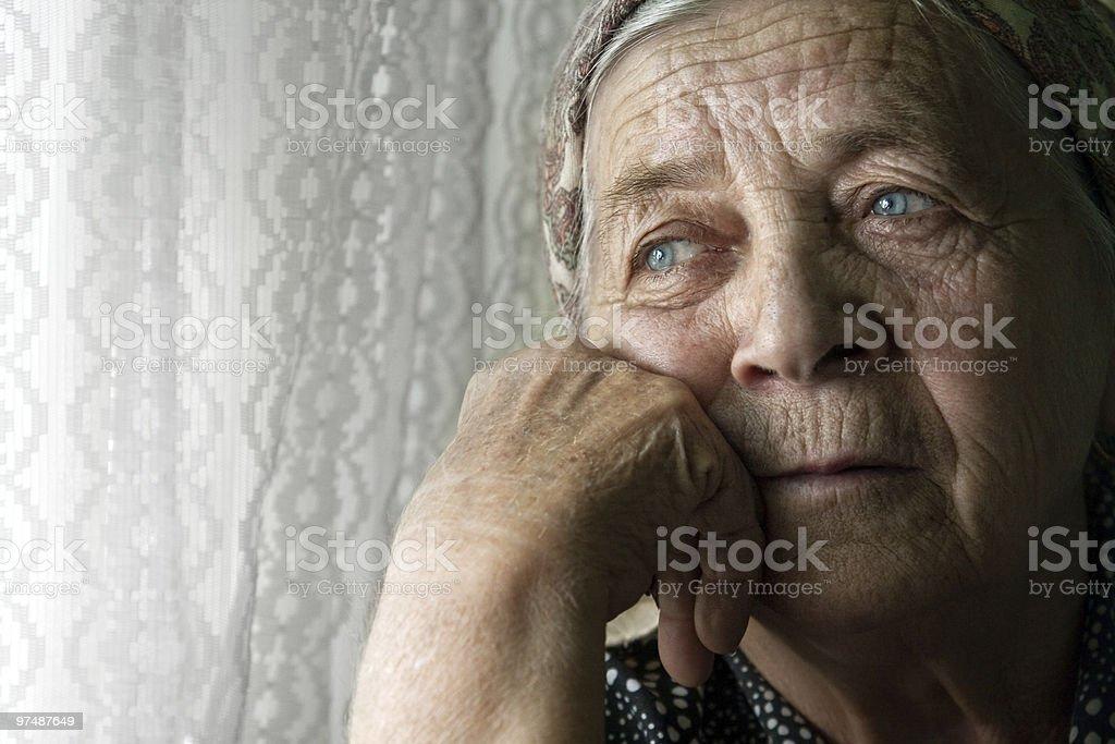 Sad lonely pensive old senior woman royalty-free stock photo