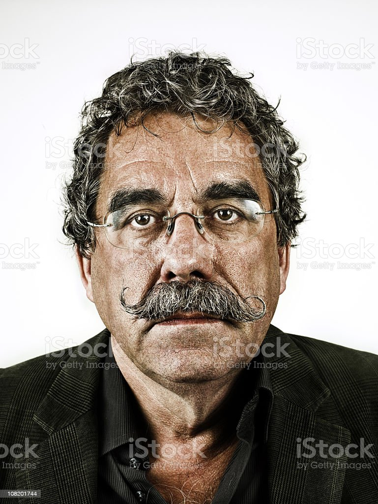 sad looking adult with moustache stock photo