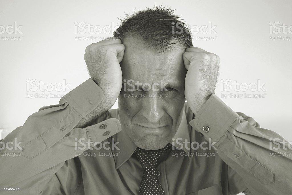 sad man cuffed stock photo