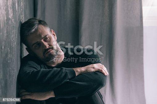istock Sad man during autumn weather 875254266
