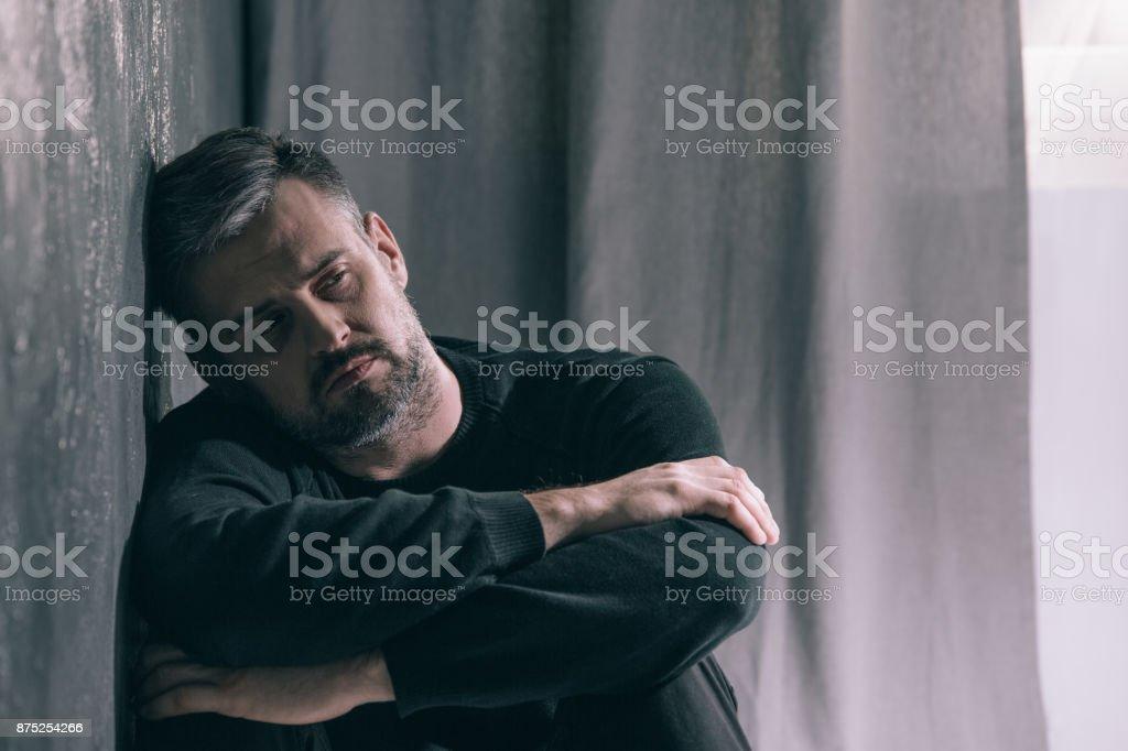 Sad man during autumn weather stock photo