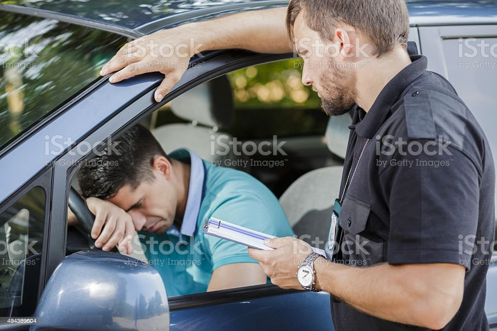 Sad man in car stock photo