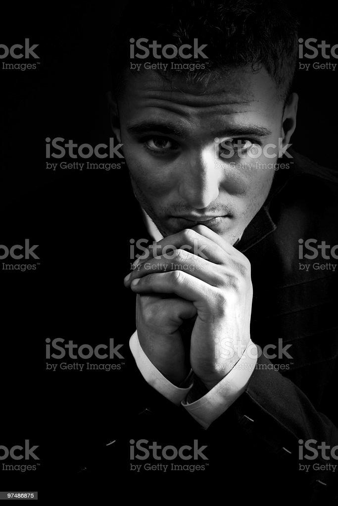 Sad man in the dark praying to God royalty-free stock photo