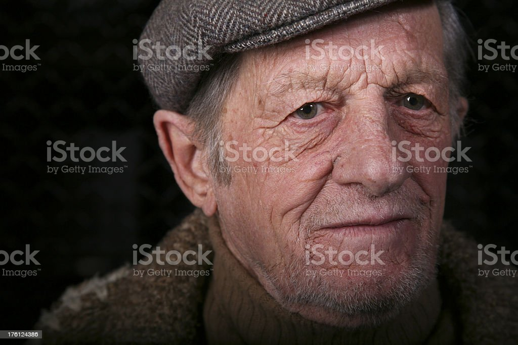Sad Man Looking Down on a Black Background stock photo