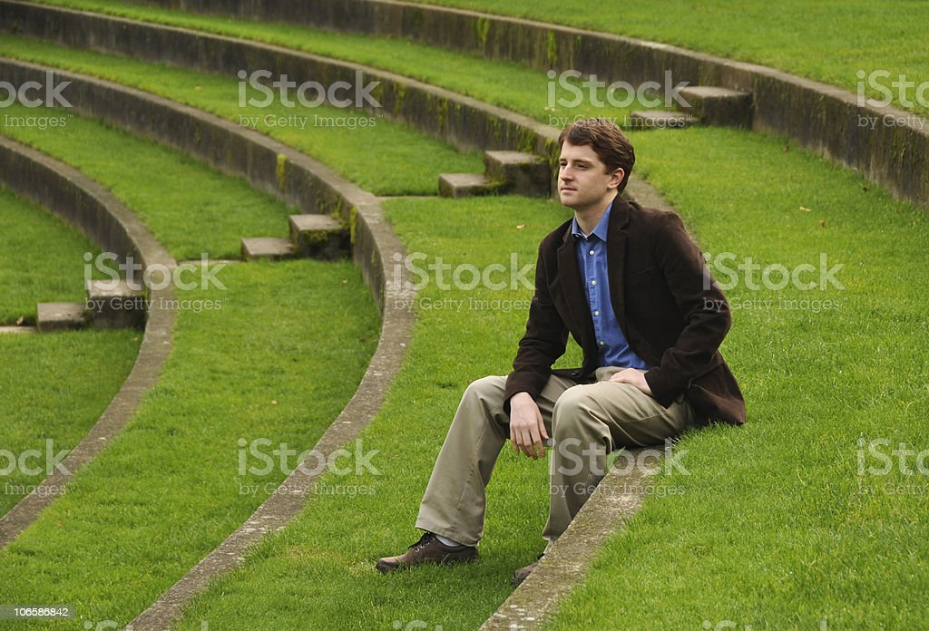 Sad Man on Grass Stairs stock photo