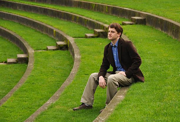 Sad Man on Grass Stairs stock photo