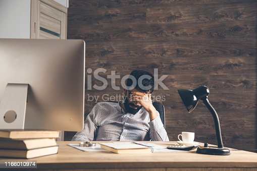 sad man sitting in office