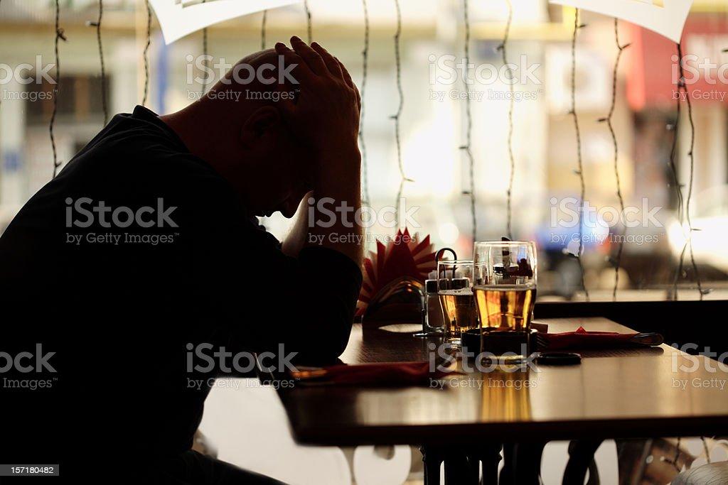 sad man sitting in restaurant royalty-free stock photo