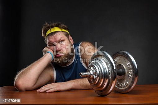 istock Sad man with a dumbbell 474970646