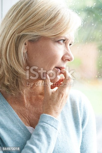 543048812 istock photo Sad Mature Woman Suffering From Agoraphobia Looking Out Of Windo 544970018