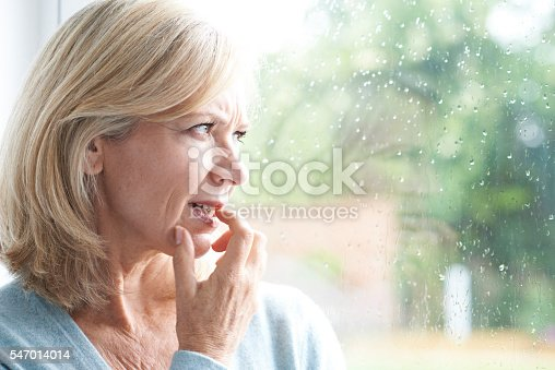 543048812 istock photo Sad Mature Woman Suffering From Agoraphobia Looking Out Of Windo 547014014
