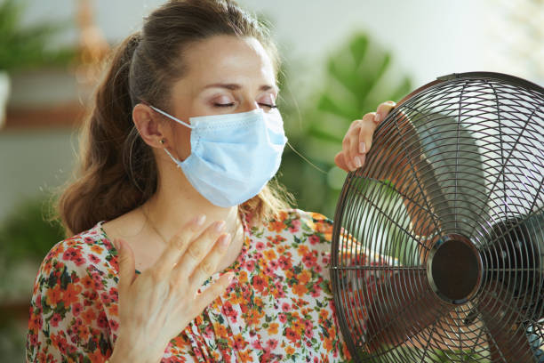 sad middle aged woman suffering from summer heat stock photo