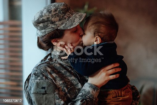 istock Sad military soldier says goodbye to her son 1065370612