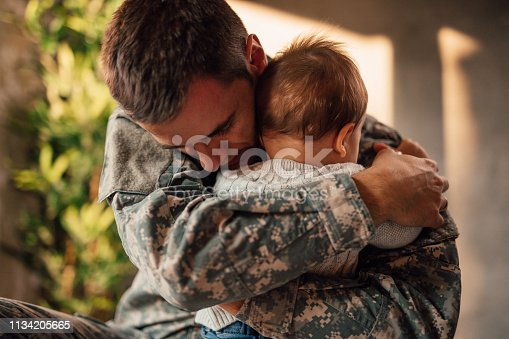 Sad military soldier says goodbye to his son