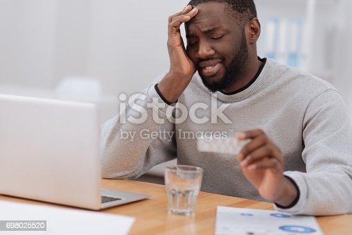 istock Sad moody man having a headache 698025520