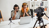 Sad movie. Couple of bloggers, young man and woman looking sad, crying while watching something on laptop, recording reaction video blog or vlog. Content creator, filming, blogging. Web Banner