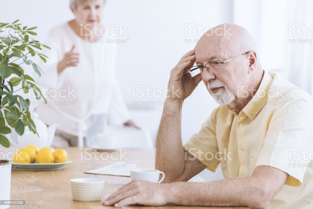 Sad old man with coffee stock photo