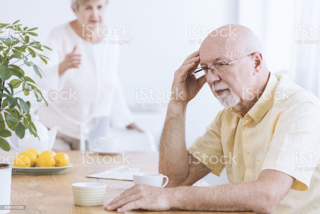 Sad old man with coffee stock photo