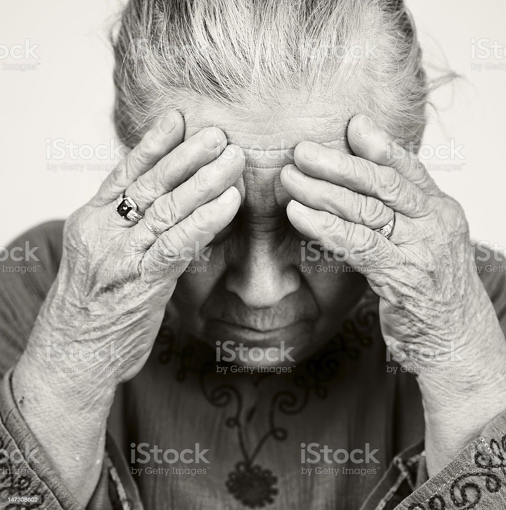 Sad old senior woman with health problems royalty-free stock photo